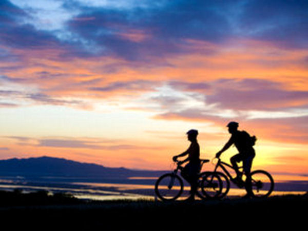 View of 2 bikers at sunset