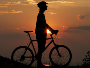 Cycling Provence, France - Biker at sunset.