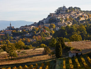 Provence bike tour - View up to the hill-top village of Bonnieux.