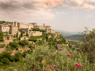 Provence bicycle trips - View across the valley to the hill-top village of Gordes.