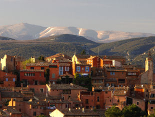 Provence cycling trips - View of Roussillon village with Mont Ventoux in the background.